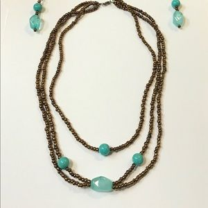 Bronze beaded necklace set with turquoise accent